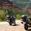 Two buddies head west over many mountain passes, through lots of red rocks.