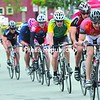 Competitors in men's category 5 look for an advantage by drafting as they race along Main Street during the Saranac Lake Criterium races on Sunday. For results, see Page B4.<br><br>(P-R Photo/Pat Hendrick)