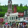 The bell tower of Harrietstown Town Hall looms overhead as racers compete in the men's category 5 during the Saranac Lake Criterium races on Sunday.<br><br>(P-R Photo/Pat Hendrick)