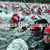 Space is at a premium as competitors in the Ford Lake Placid Ironman Triathlon react the starting gun Sunday morning on Mirror Lake.<br><br>(P-R Photo/Pat Hendrick)