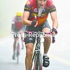 Cloud cover three miles up the mountain is so thick that the rider pursuing Dan Reilly of Saranac Lake is barely visible behind him. Reilly won the men's age 50-59 division in 1:01:08.4 in Sunday's NYSEF Whiteface Foliage Bike Hill Climb.<br><br>(P-R Photo/Pat Hendrick)