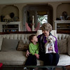 Cindy Chew<br /> 1/29/14<br /> Patricia Hollowell sits with her grandson Cody, 3, and dog Carla at her daughter's home in San Rafael.  Hollowell, who was diagnosed with melanoma in 2012, has seen her tumors go down since undergoing immunotherapy treatment at UCSF.