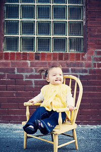 Oh my goodness. What a doll. She did love the little chair! and the little yellow bumble bees...so cute!