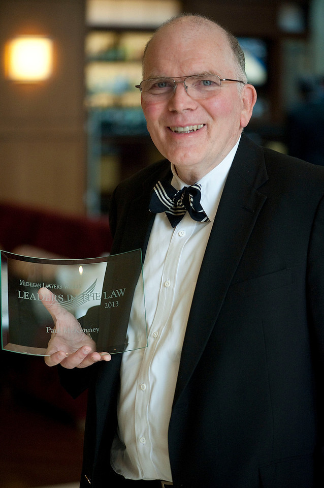 Paul McKenney shows his Leaders in the Law award in Troy, MI on March 21, 2013.