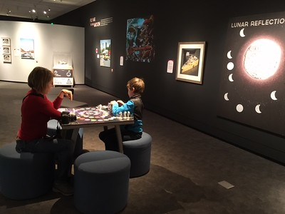 My daughter and grandson playing a game in the Lunar scapes exhibit at PEM, November 2016