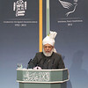 Ref 012:   Hadhrat Khalifatul Masih V delivering his keynote address at the 2012 Peace Symposium