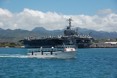 the smaller boat the Navy uses to take visitors to the USS Arizona memorial