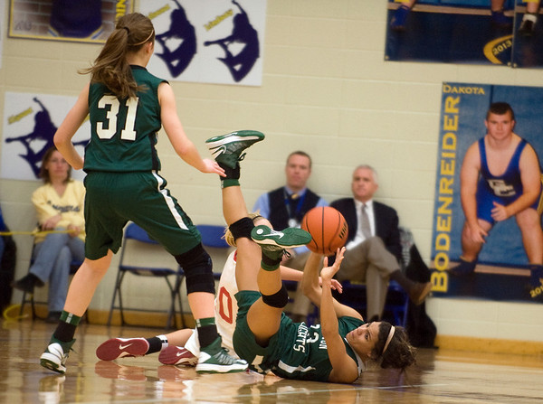 After scrambling for a loose ball on the floor Pendleton's Kiawna Coottrell passes it to her teammate Skya Baird. In IHSAA girls basketball section #9 first round action Pendleton Heights falls to Connersville 32 to 31 at Greenfield Central High School Tuesday, February 5, 2013. Photo by Richard Sitler