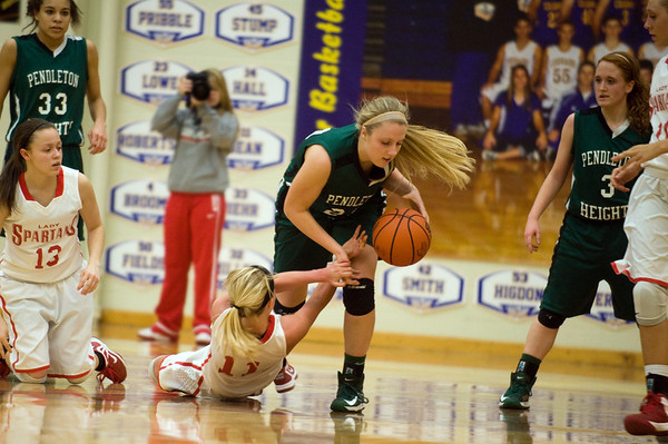 During the fourth quarter Pendleton Heights senior Kenzie Gustin grabs the ball from Connersbville's Taylor Stephen after a scramble for the loose ball. In IHSAA girls basketball section #9 first round action Pendleton Heights falls to Connersville 32 to 31 at Greenfield Central High School Tuesday, February 5, 2013. Photo by Richard Sitler