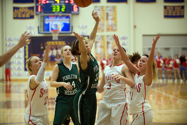 As the clock runs down Pendleton's Kiawna Cottrell tries to grab a rebound away from Connersville's Courtney Phillips,Kenzie Weston and Taylor Stephen.  In IHSAA girls basketball section #9 first round action Pendleton Heights falls to Connersville 32 to 31 at Greenfield Central High School Tuesday, February 5, 2013. Photo by Richard Sitler