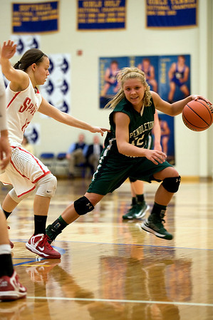 Pendleton Heights' Tiffany Wertz looks to drive past Connersville's Destiny Ruch during the third quarter. In IHSAA girls basketball section #9 first round action Pendleton Heights falls to Connersville 32 to 31 at Greenfield Central High School Tuesday, February 5, 2013. Photo by Richard Sitler