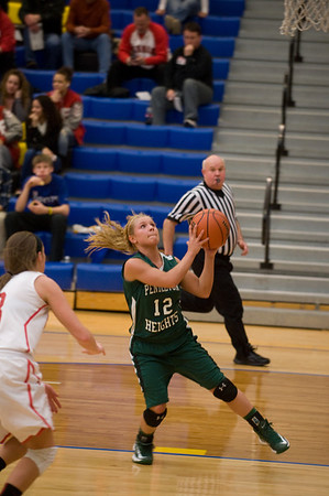 Pendleton Heights guard Tiffany Wertz attempts a layup on a fast break. In IHSAA girls basketball section #9 first round action Pendleton Heights falls to Connersville 32 to 31 at Greenfield Central High School Tuesday, February 5, 2013. Photo by Richard Sitler