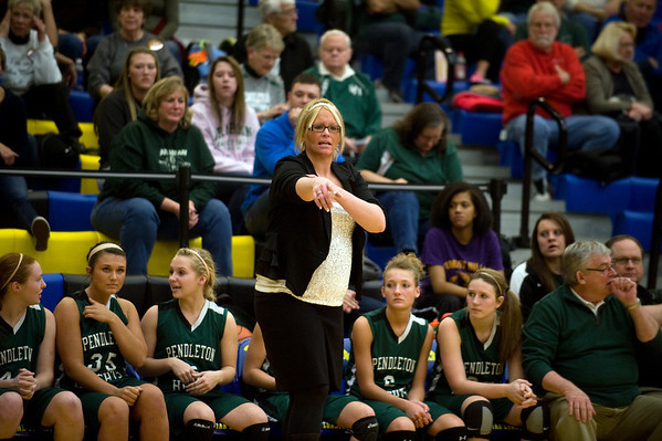 Pendleton Heights Coach Holly Hollinger calls out directions to her team during the second half. In IHSAA girls basketball section #9 first round action Pendleton Heights falls to Connersville 32 to 31 at Greenfield Central High School Tuesday, February 5, 2013. Photo by Richard Sitler