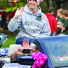 Grand Marshall Andrea Vallinga waves to the crowd as the parade goes through town.