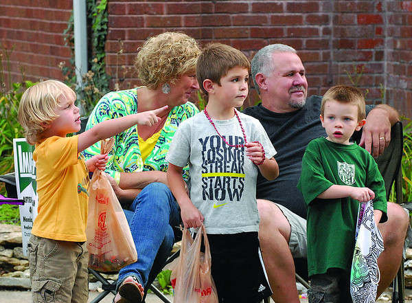 Youngsters watch the parade along State Street in downtown Pendleton.