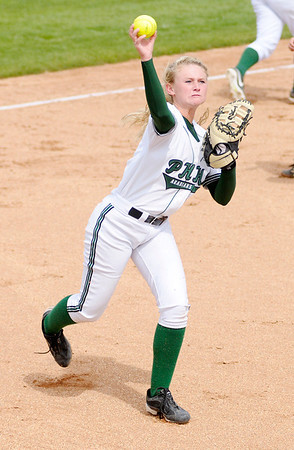 Pendleton Heights' Morgan Hubble throws a runner out at first after fielding a bunt.