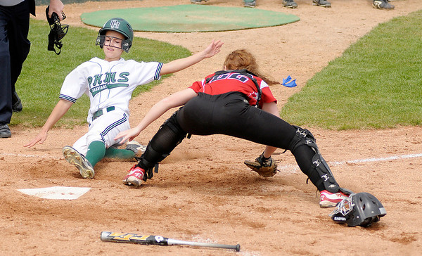 Pendleton Heights' Heather Wendling slides into home beating the tag of Center Grove's Mallory Baker.
