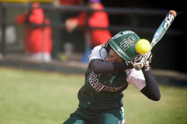Pendleton Heights junior Delilah Wright ducks to avoid being hit by a pitch as she bats in the first inning. Pendleton Heights High School defeated Elwood High School in the Madison County softball tournament championship game Saturday, April 13, 2013. Photo by Richard Sitler
