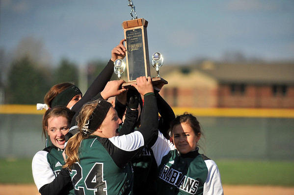 Pendleton Heights girls softball players hold up the trophy as they celebrate their county tournament championship. Pendleton Heights High School defeated Elwood High School in the Madison County softball tournament championship game Saturday, April 13, 2013. Photo by Richard Sitler
