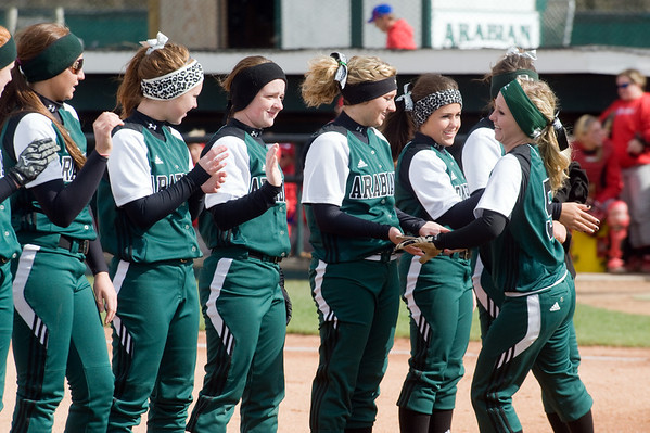 Sydney Windlan slaps hands with her teammates as the Pendleton Heights lineups are announced prior to the Madison County softball tournament championship game between Pendleton Heights High School and Elwood High School Saturday, April 13, 2013. Photo by Richard Sitler