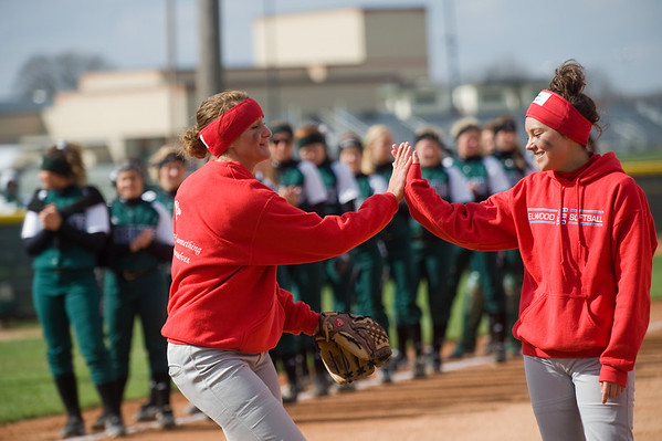 Elwood players slap hands as the lineups are called prior to the championship game of the Madison County softball tournament between Elwood High School and Pendleton Heights High School Saturday, April 13, 2013. Photo by Richard Sitler