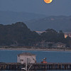 Super moon over Monterey bay with airport and commercial wharf in forground.