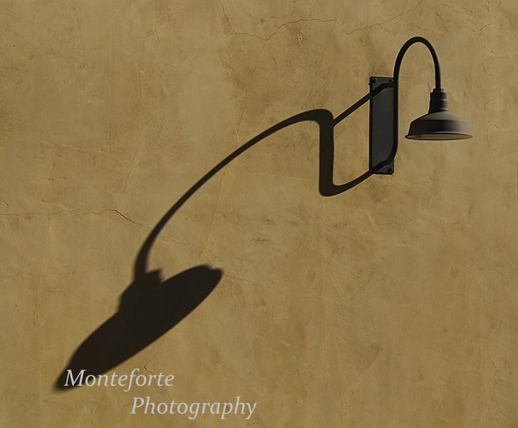 Light shadow on stucco wall.
