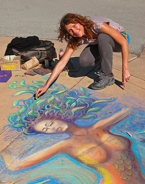 Amanda doing a chalk drwaing on the sidewalk near San Carlos beach, Monterey Ca.