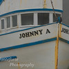 Johnny A sitting in boat repair yard Monterey California on a foggy day.