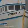 Johnny A sitting in boat repair yard Monterey California on a foggy day.