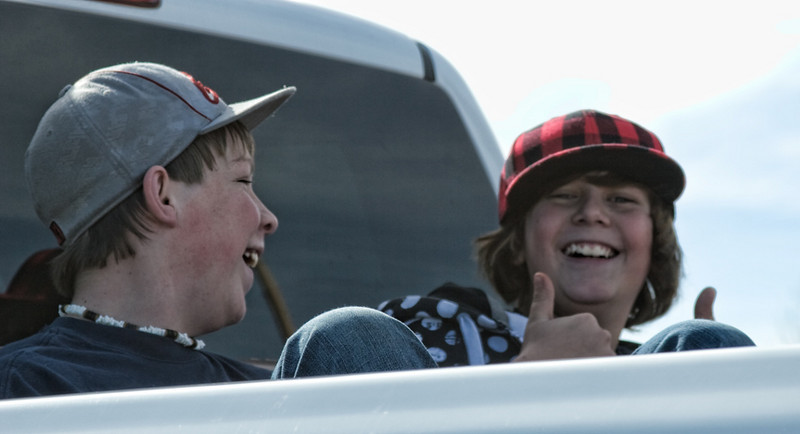 Two kids having fun in the back of a pick-up!