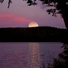 Moon Over Parks Pond...The setting sun created the red sky for the rising full moon. Image take from my dock on Parks Pond in Clifton, Maine........ This shot is the result of several images stitched together.