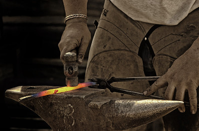 Blacksmith hammering. Received honourable mention in the Western Lifestyle category of the Calgary Stampede Photo Contest - 2013.