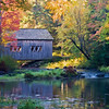 Fall in Maine. Covered bridge at Leonards Mills.