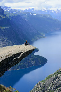 Sitting on the edge of Trolltunga in Norway