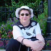 Susan sitting in a Charleston park garden on the Cooper River - same trip w/ me in chair!