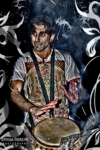Drum circle player 1