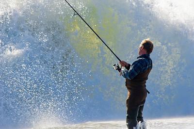 Surf Fisherman against Wave