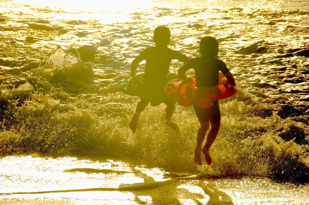 Boy & Girl in Surf at Sunset