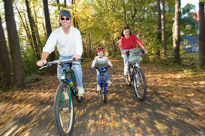 Family Biking in Autumn Leaves