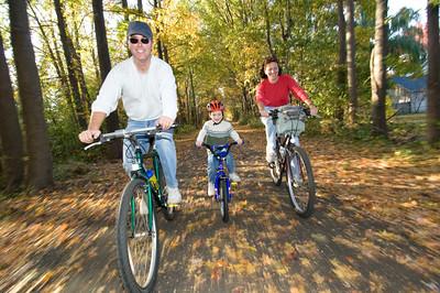 Family Biking in Autumn Leaves