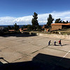 Boys play soccer on basketball court, Isla Amantani.  No electricity exists on this beautiful Quechua inhabited island in the middle of Lake Titicaca - the highest navigable lake in the world at over 12,000 feet elevation.