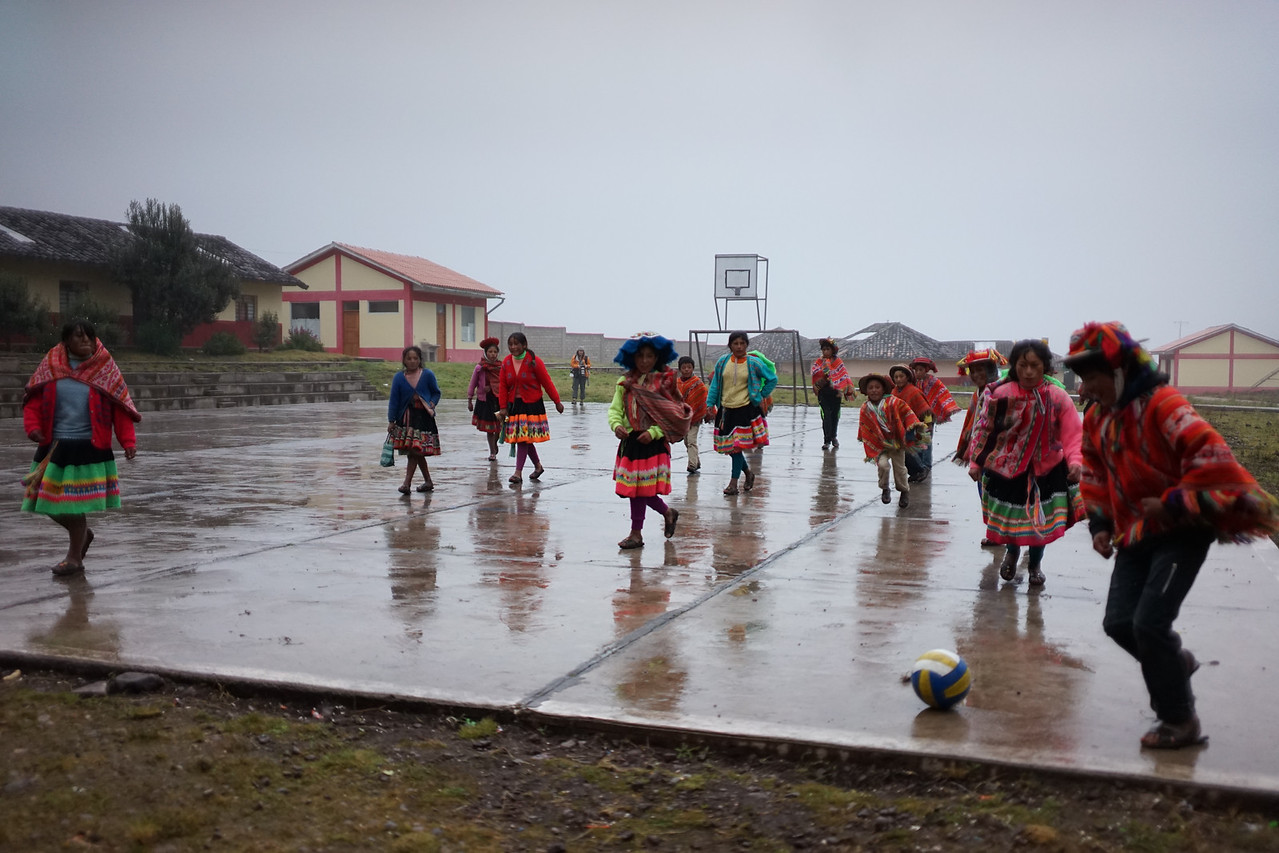 Despite the rain, a soccer game was going on.
