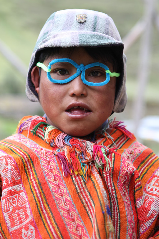 David (Bolivian translator) and Bhargavi are in charge of education today.  They have a blast with the children and half the town is wearing these by the end of the day.