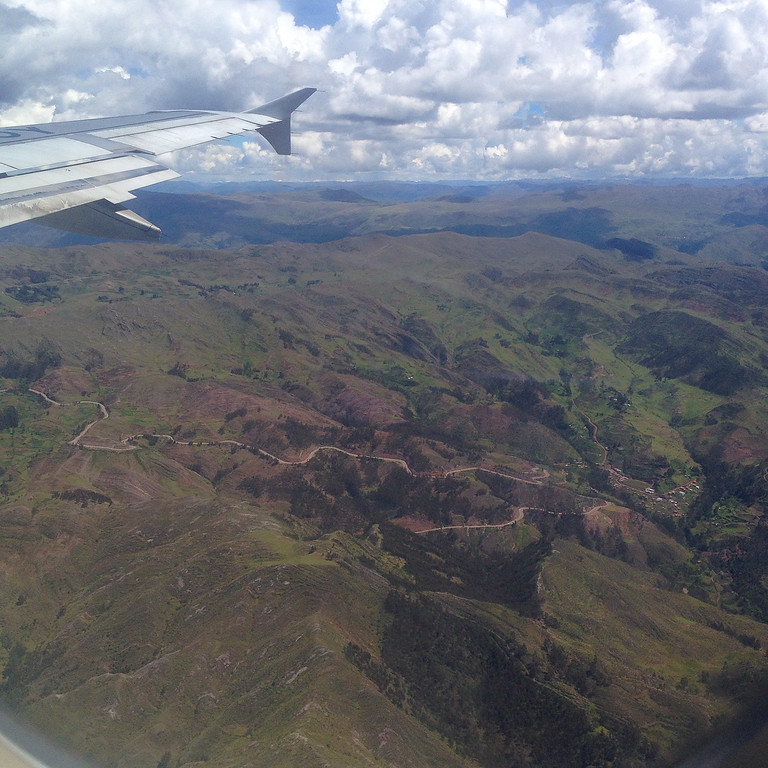 We dip and turn through the mountain peaks to land at 13,000 feet in Cusco, a city in the Southeastern part of the country.