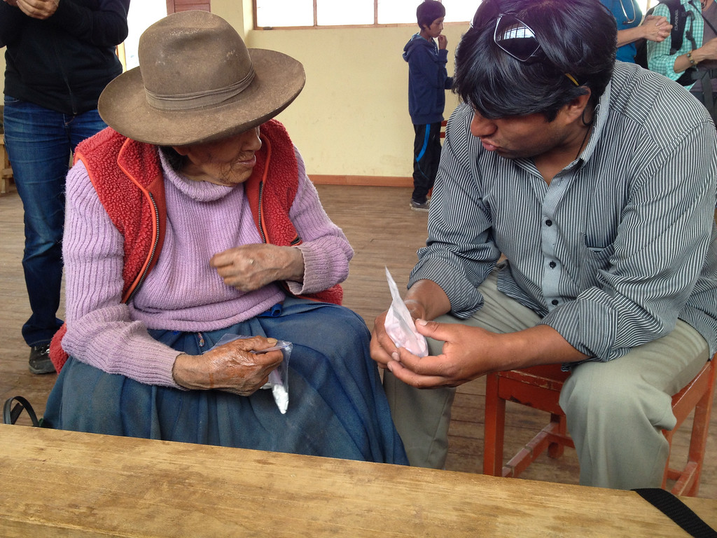 Our van driver helping translate as this elderly woman spoke a language called Quechua.