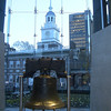 The Liberty Bell with Independence Hall in the background.