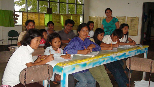 A new deaf school started in Mindanao in the Philippines next to Mountain View SDA College.  This is a temporary classroom while they are building a boarding school about 35 km from here.  The plan is to start at the new location in June 2013.  The Gospel Outreach Lay Bible worker, Sarah Famisaran, is standing in the back in the green dress.