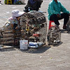"""Woman """"selling"""" cages of birds to set free at riverside, Phnom Penh"""