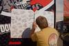 Fans signing the Doug Herbert banner!